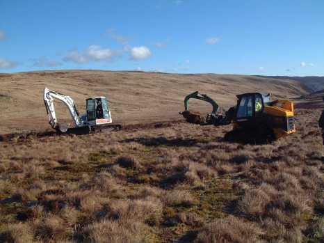 Drain blocking at Lake Vyrnwy using heather bale and peat dams (Credit: LIFE Active Blanket Bogs in Wales/Wildlife Trust Northumberland)